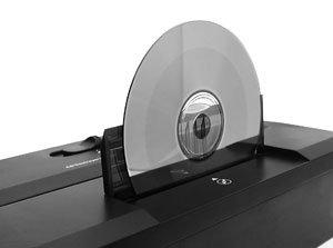 Soulevez le couvercle de sécurité pour insérer les CD et DVD