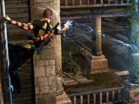 Cole zapping a human enemy while hanging from the side of a building in inFAMOUS 2