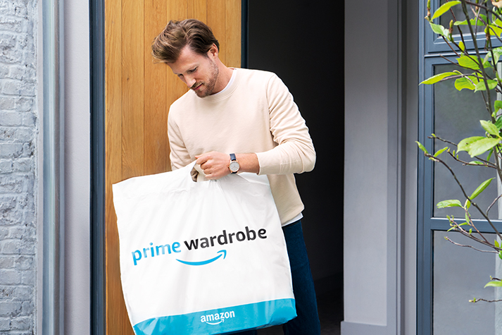 Man holding his Prime Wardrobe package