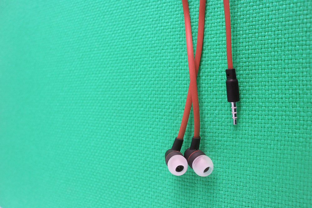 Photo earphone or earphones on color background the earbud for using digital music or smart phone