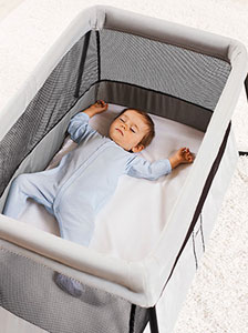 The BabyBjorn Travel Carry Cot Light with sleeping baby