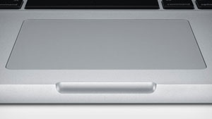The 13-inch MacBook Pro features a combined, multi-touch trackpad and operation button