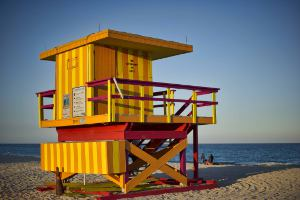 Picture shows a lifeguard's brightly coloured beach hut on a Florida, USA beach.