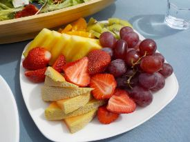 Picture shows a close-up view of fruit on a plate.