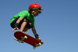 Picture shows a boy on a skateboard in mid-air.