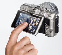 Tilting, touch sensitive LCD