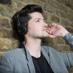 The Script wearing headphones