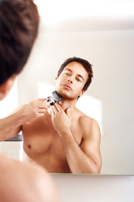 Shaving in mirror