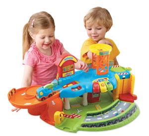 Children playing with Toot-Toot Drivers Garage