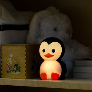 Danny the Penguin in use on a shelf