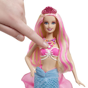 Press the pearl to transform Barbie