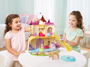 Girls playing with the Magical Talking Castle
