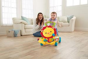 Baby pushing Musical Lion Walker