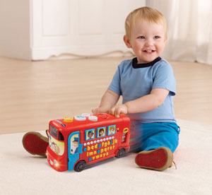 Boy playing with Playtime Bus