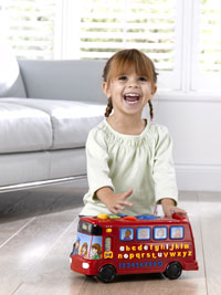 Child playing with Red Playtime Bus