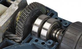 Schlagbohrmaschine mit 1050 Watt mit 2-Gang-Getriebe und Zusatzhandgriff mit Zahnkranzbohrfutter - Funktion