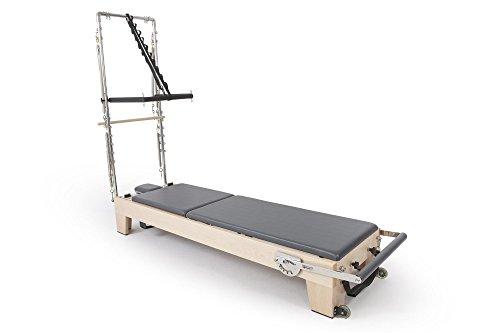 Elina pilates. reformer elite in legno con torre - situati in prima linea in pilates con la più alta gamma di reformer sviluppata el contributo di tecnici di pilates di tutto il mondo.