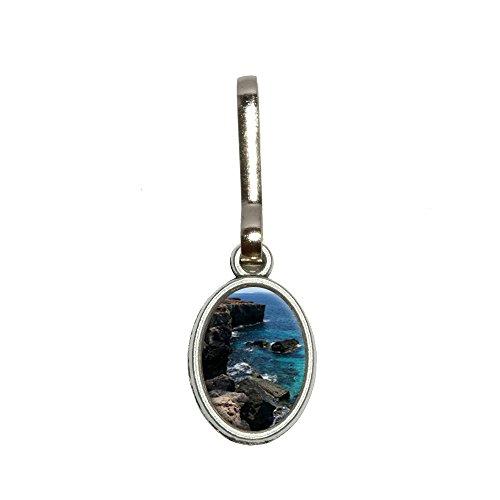 caribee-mallorca-cala-rocky-shore-ocan-bleu-deau-en-charme-ovale-vtements-sac-main-bagages-sac-dos-f