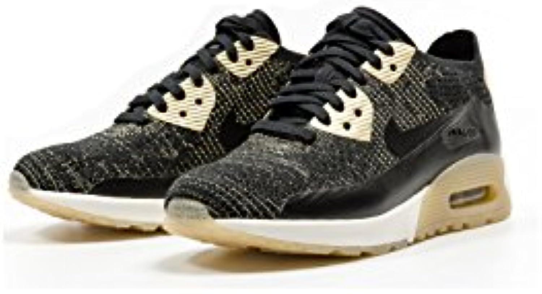 Nike - Zapatillas para mujer negro y dorado