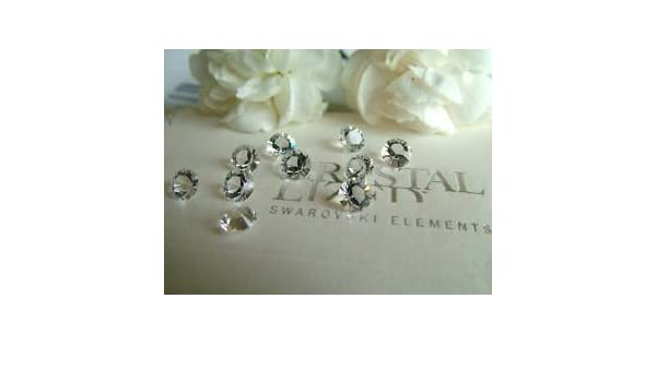 fcd8f6b72f3e 100 CLEAR SS24 SWAROVSKI Table Diamond Scatter Crystal - 5.5mm   Amazon.co.uk  Toys   Games