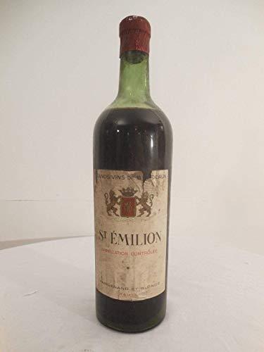 saint-émilion margerand et blonde rouge années 50 - bordeaux france: une bouteille de vin.