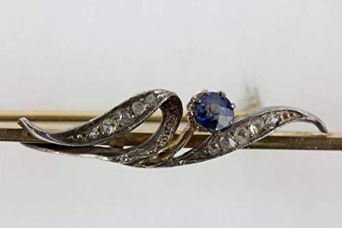 Krawattennadel, Anf. 20. Jh, Fuchs Wien, 585er Gold, mit aufgelegter Blume, Saphir (Nicht komplett durchgefärbt) als Blüte, Blätter mit Diamantrosen (Saphir-krawattennadel)