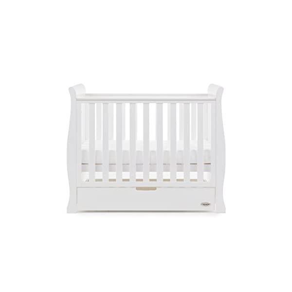 Obaby Stamford Sleigh Space Saver Cot - White Obaby Adjustable, 3 position base height Discreet under drawer included for extra storage Teething rails ensure delicate teeth are protected 3