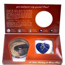 Perla del desiderio. Trova la perla nell'ostrica, guarda il significato del suo colore e custodiscila nel tuo ciondolo a cuore.
