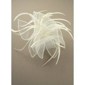 Ladies cream chiffon and feather fascinator on ribbon bound clear comb. Ideal for wedding, ladies day, christening or any other special occasion. by NA