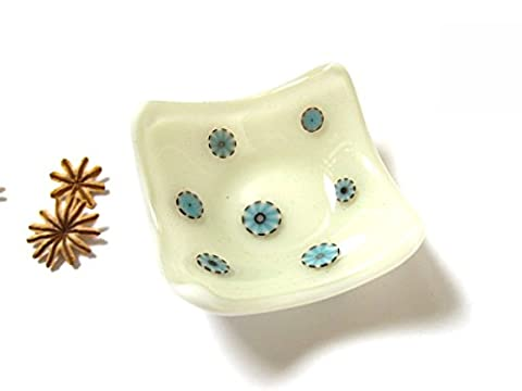 Small cream and blue fused glass candle holder dish. Modern design occasion dish for earrings, candles, rings or anything you can think of. Lovely soft colours which mix and match to suit any room. Looks great as a desk accessory for bits and pieces. Glass bird not included, see separate