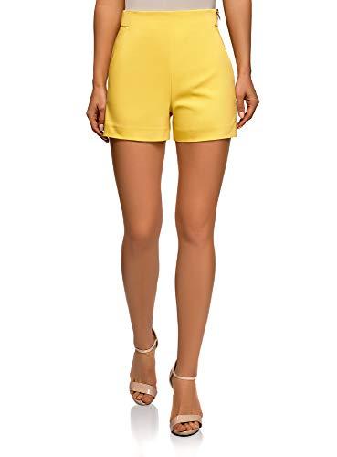 Pantalones cortos amarillos con cremallera en el lateral