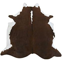 Alfombra piel de vaca. Medidas: 250x215 cms. 100% Natural. Piel procedente de Brasil, consideradas las mejores pieles bovinas del mundo por su curtición y brillante pelo.