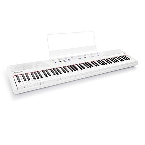 Alesis Recital White - 88-Tasten Einsteiger Digital Piano / E Keyboard mit halbgewichteten Tasten, Netzteil, zwei eingebauten 20 Watt Lautsprechern und fünf Premium-Stimmen, 3-Monatsabo Skoove, weiß