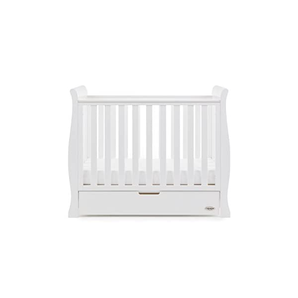 Obaby Stamford Sleigh Space Saver Cot - White Obaby Adjustable, 3 position base height Discreet under drawer included for extra storage Teething rails ensure delicate teeth are protected 4