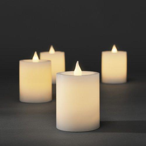 Konstsmide 1986-100 - Juego de velas sin llama con luces LED, 4 unidades, mando a distancia, 8 diodos, para interior, color blanco