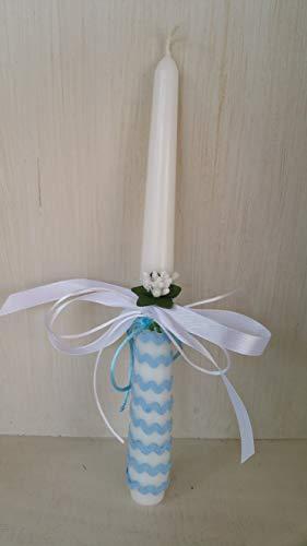 Vela bautizo niño de cera blanca, vela primera comunion,decorada con lazo color azul y flor .medida altura 25 cm.