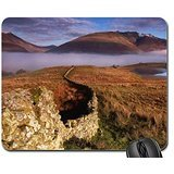 stone-wall-to-mountains-draped-by-fog-mouse-pad-mousepad