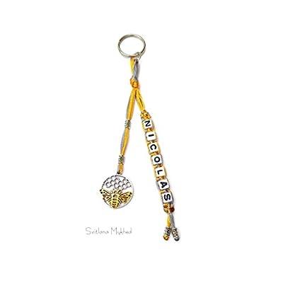 """Breloque Porte clés """"Nicolas Abeille Miel"""" (réversible) personnalisable avec prénom ou message"""