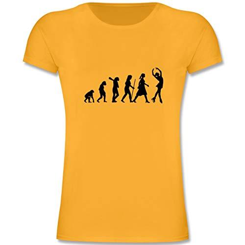 Evolution Kind - Eisläuferin Evolution - 128 (7-8 Jahre) - Gelb - F131K - Mädchen Kinder T-Shirt