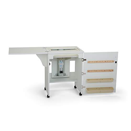 """El mueble de costura Sewnatra es compacto y cuenta con un cómo sistema de aire para elevar la máquina de coser. Tiene un diseño duradero y está acabado e laminado negro.El mueble es para máquinas de hasta: 48 cm (18 7/8 """") de ancho, 31.9cm (12 9/16 """"..."""