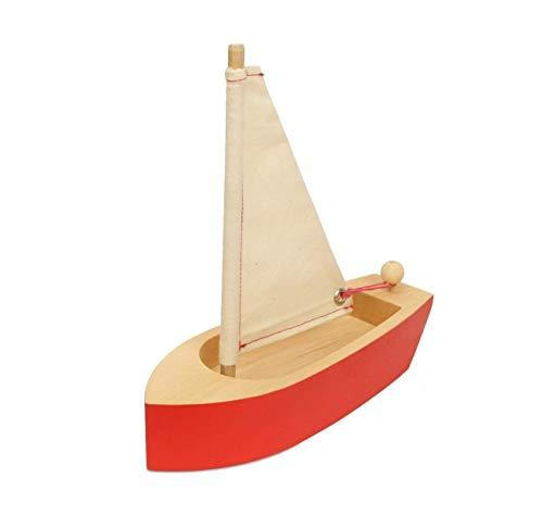 Spielzeugboot in Rot aus massivem Holz mit Natursegel