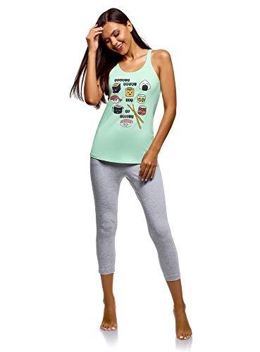 Pijama de punto con top de tirantes y pantalones de algodón natural. El top ancho de tirantes lleva un profundo escote y un estampado único en la parte delantera. Los pantalones piratas de talle medio de corte recto llevan bolsillos en los laterales ...