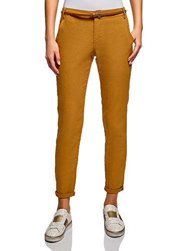 Pantalones ajustados amarillos de mujer con cinturón