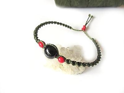 Bracelet Brésilien/Amitié/Unisexe en fil Vert Kaki tissé main en macramé tissage forme spirale avec perles naturelles en graines Acai et Achira teintées.