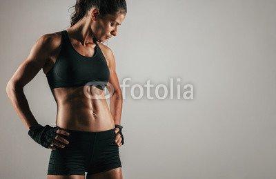 druck-shop24 Wunschmotiv: Tough woman with tight abdominal muscles #121103002 - Bild als Foto-Poster - 3:2-60 x 40 cm/40 x 60 cm -