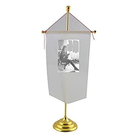 Table flag with Ludmilla Tcherina holding footwear.