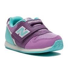 New Infant Schuhe Balance (NEW BALANCE - Violett-hellblauer Sportschuh infant, aus Synthetik und Mikrofaser, mit Klettverschluss, Mädchen-25)