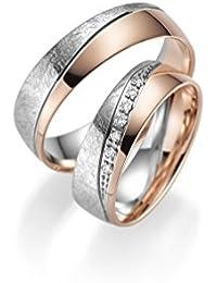 c12604889c86 Par de alianzas de oro 333 en oro rojo y blanco con piedra