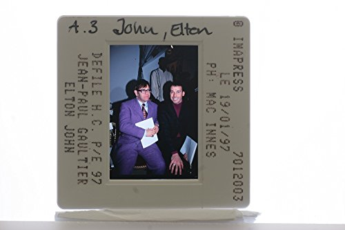 slides-photo-of-sir-elton-hercules-john-sitting-with-jean-paul-gaultier