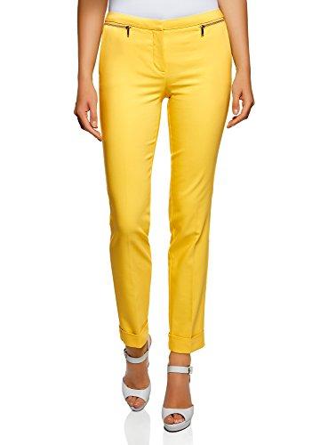 Pantalones amarillos ajustados con cremalleras decorativas